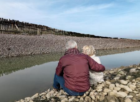 mature, couple, sitting, on, beach - 18428096