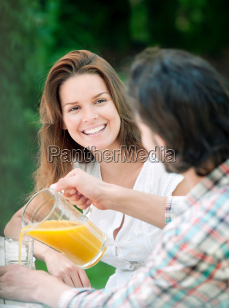 man and woman having drink in