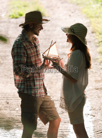 man and woman with model boat
