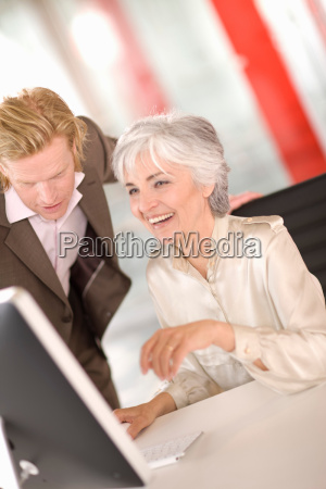 woman and man working in an
