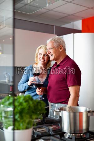 senior couple holding wine glasses