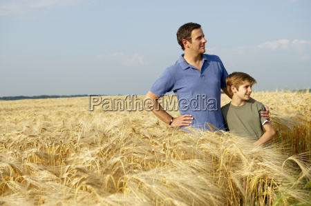 father and son in a wheat