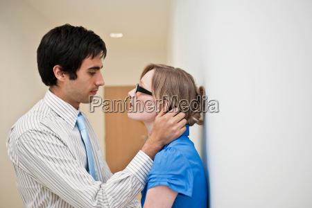 couple embracing in corridor