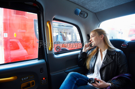 woman on the phone in taxi