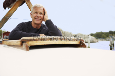 middle aged man on old boat