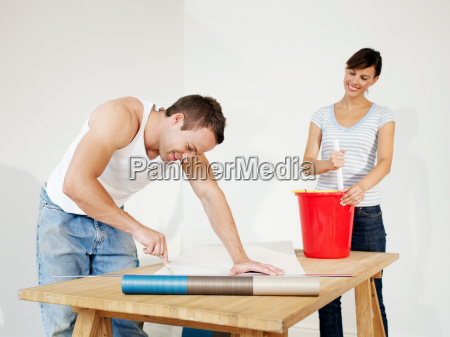 couple preparing wallpaper
