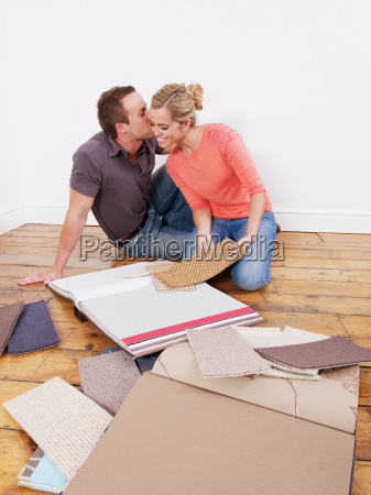 couple, looking, at, carpet, samples - 18431798
