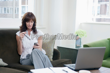 business women working on mobile phone
