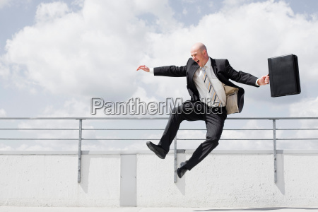 man jumping in the air with