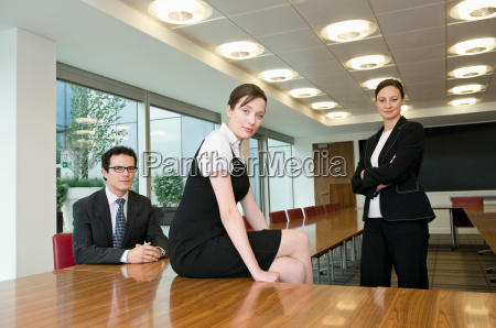 a portrait of three business people