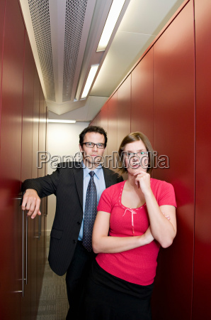 business couple in a store cupboard