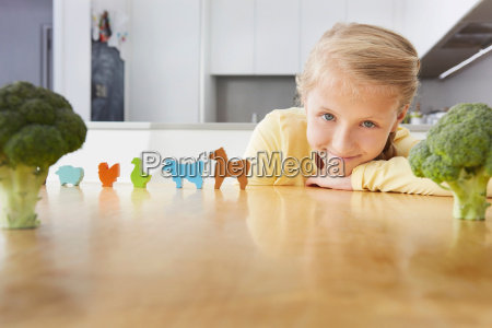 girl playing with toy animals around