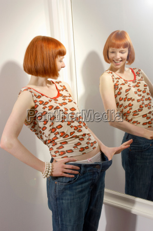 woman looking at weight loss in
