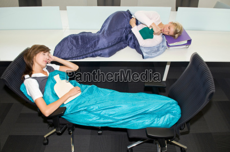 business women sleeping in the office