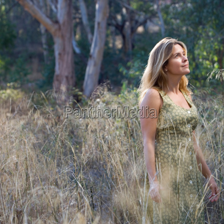 smiling woman standing in a field