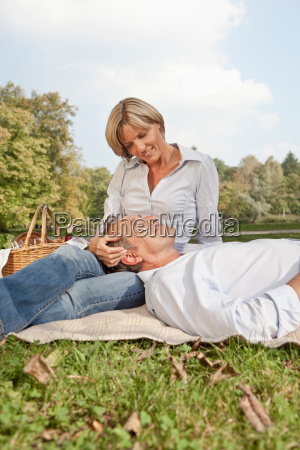 middle aged couple on a picnic