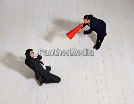 business woman shouting at man on