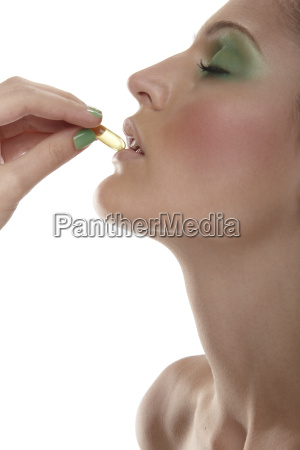 woman taking vitamin pill
