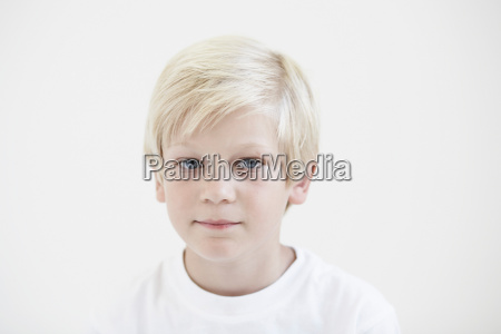 portrait young boy looking to camera