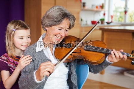 grandchild watching grandma making music