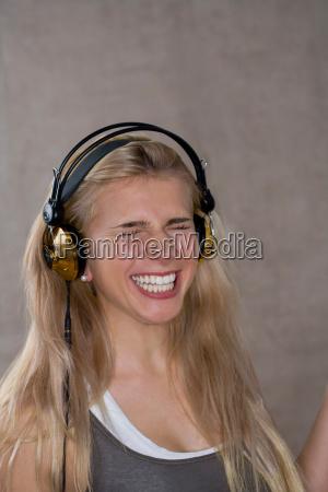 teen girl smiles wears headphones