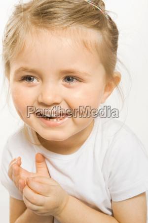 close up of toddler girl smiling