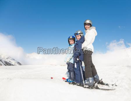 woman two boys wearing skis