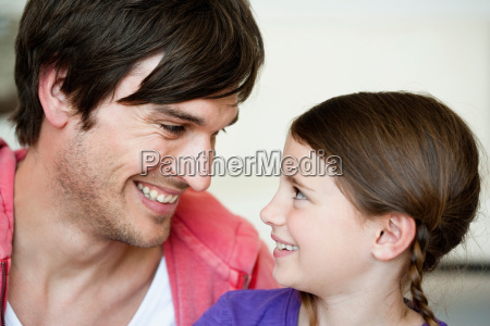 father and girl looking to each