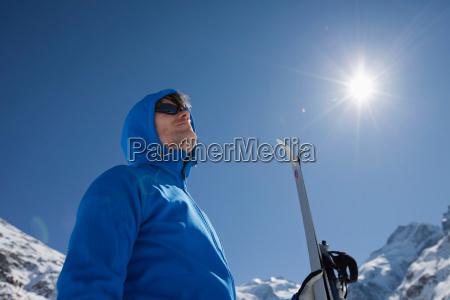man with cross country ski in