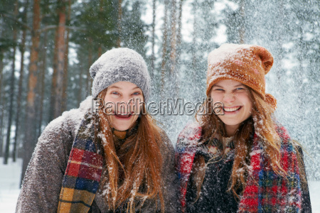 young women outside in heavy snow