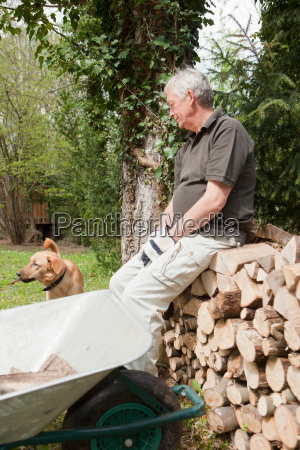 older man resting with dog in