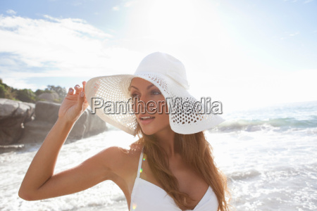 woman wearing sunhat on beach