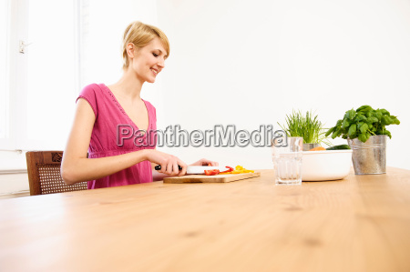 young woman at home preparing food