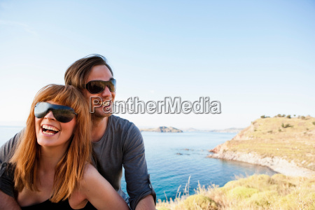young couple in front of seaside