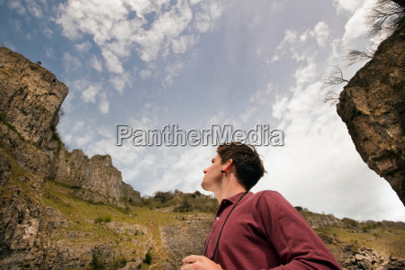man with binoculars in valley