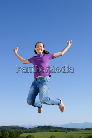 girl jumping in air happy