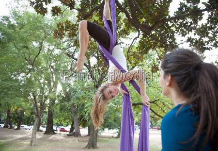 two young woman doing acrobatics in
