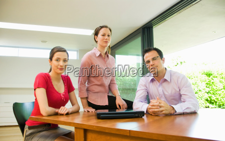 portrait of 3 business people
