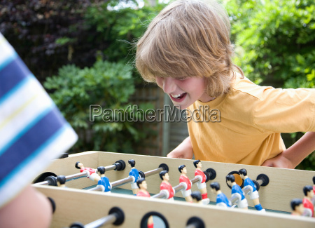 two boys 8 11 playing table