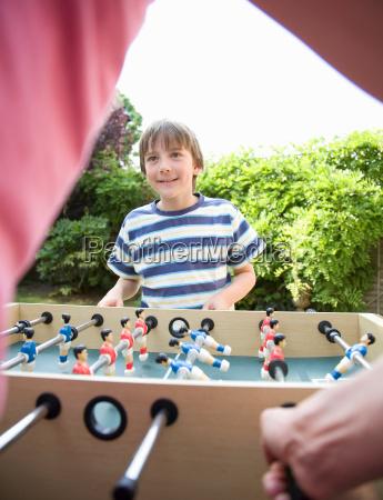 boy 8 9 playing table football