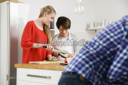 mother and daughter preparing food in