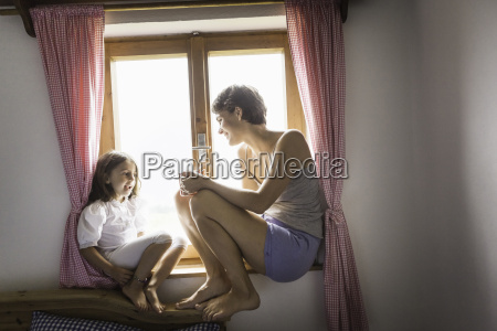 young woman and daughter in holiday