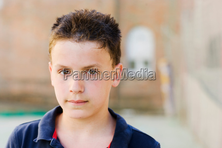 boy looking to the camera on