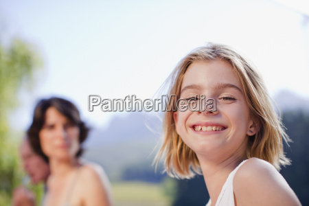 young girl smiling outdoors