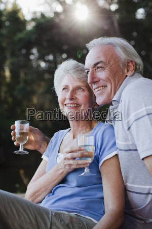older couple drinking wine outdoors
