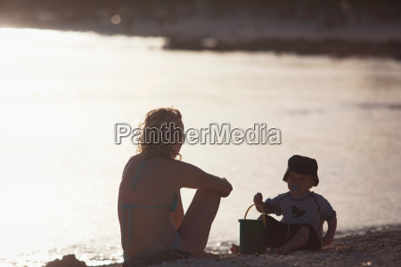 mother and toddler son playing on