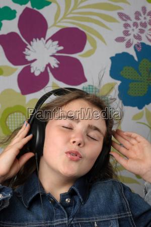 girl listening on headphones singing