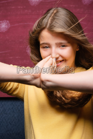 young girl with hands to face