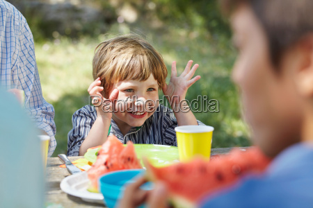 gesticulating little boy at picnic