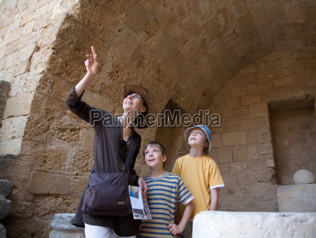 woman and two boys at historical